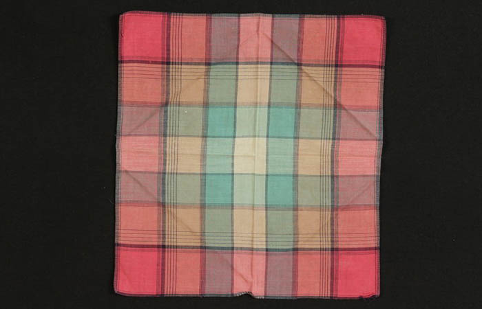 Orange plaid scarf found by 14-year-old Ruth Krautwirth while imprisoned at Auschwitz-Birkenau