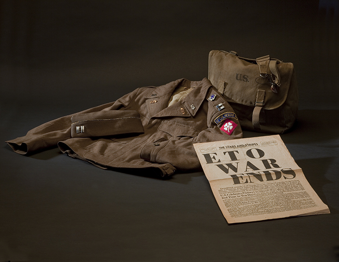 This jacket, cap, and canvas bag belonged to J. George Mitnick, a Jewish American captain in the US Army who helped liberate Ohrdruf.