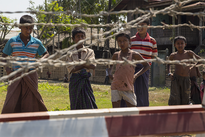 "An estimated 4,250 Rohingya live in the Aung Mingalar ghetto in  Sittwe, segregated from their Rakhine neighbors. Police officers and barricades mark the boundaries; many of the ghetto residents referred to it as an ""open prison."""