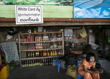 "Signs posted on storefronts and homes in Sittwe protest against Rohingya voting rights. Many Rohingya have ""white cards,"" or temporary identification cards. The central government announced the white cards would soon expire, preventing those who held them from voting in an upcoming election."