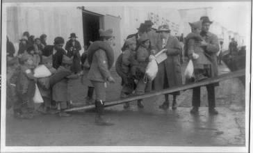 Photograph showing Near East relief efforts: Armenian orphans board a barge at Constantinople, bound for Greece. ca. 1915.