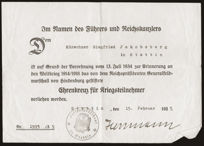 Official certificate issued to Siegfried Jacobsberg in 1935 recognizing him as a German war veteran and recipient of a medal of honor. In November 1938, Siegfried and his son were arrested during <i>Kristallnacht</i> and imprisoned in the Sachsenhausen concentration camp.
