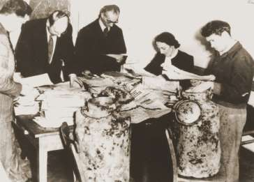 Archivists at the Jewish Historical Institute in Warsaw sort through the contents of the Ringelblum archive, retrieved from two milk cans discovered in 1946 and 1950 in the ruins of buildings in the former ghetto.