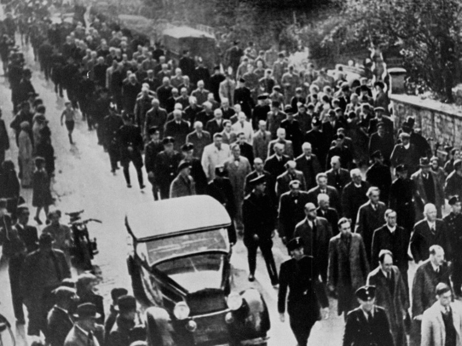 Male Jews who were arrested during Kristallnacht and forced to march through the town streets under SS guard to watch the desecration of a synagogue. They were then deported.