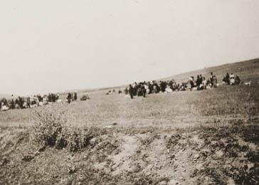 Jews at the killing site outside of Kamenets-Podolsk. Ukraine, August 27-28, 1941.