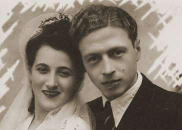 Wedding portrait of Hinda Chilewicz and Welek Luksenburg in the Weiden displaced persons' camp.