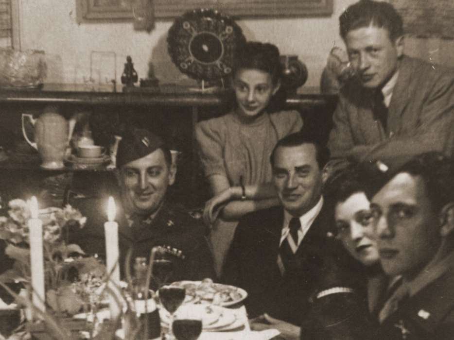 Welek Luksenburg attends a Passover seder in Bayreuth, 1946 at the home of Mary Ganzweich.