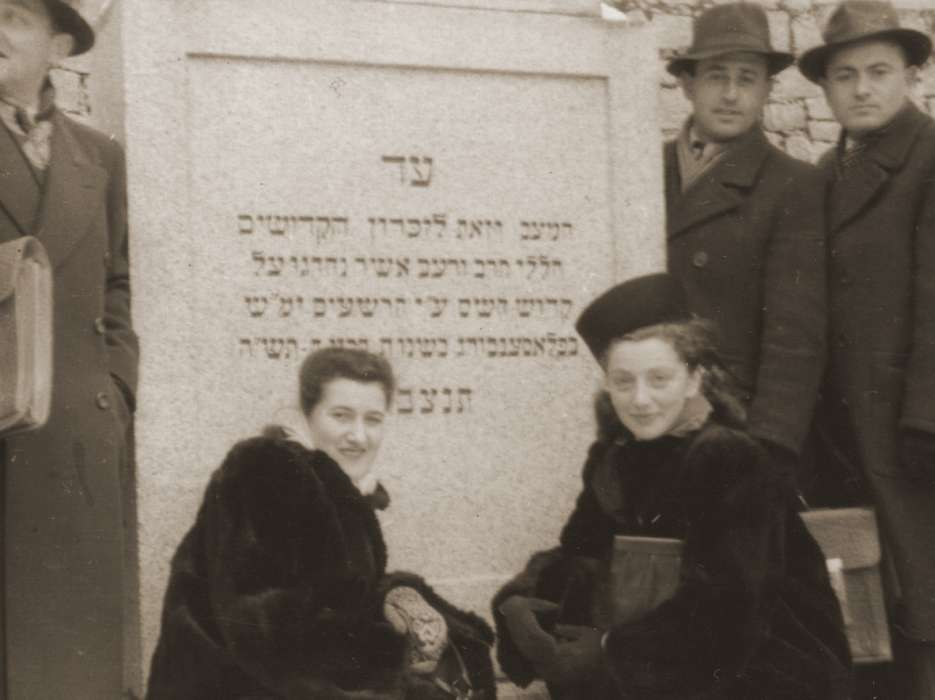 Hinda Chilewicz (left) and Sala Weingarten view a memorial for Jewish victims at the Flossenbuerg concentration camp.