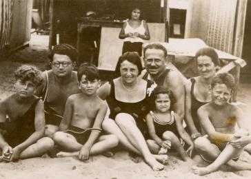 A prosperous Jewish family poses in front of a beach cabana while on vacation in Lido. Pictured are the Morawetz family: Felix, Erni, Bruno, Lilly, Gottlieb, Margit, Yeya and Paul.