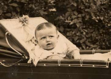 Portrait of Sala Perec in a stroller.