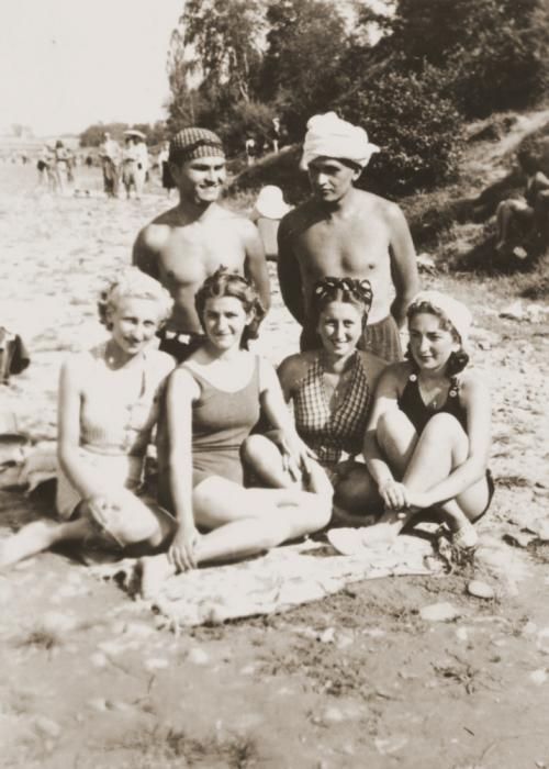 Three Jewish girls relax with a Romanian friend on a beach while in hiding. Pictured are Cila Loewenthal, Beatrice, and Erika Neuman.