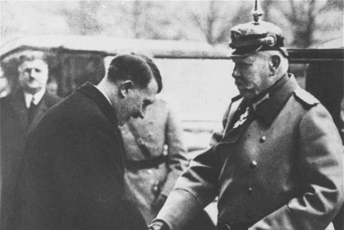 Adolf Hitler greets President Paul von Hindenburg at the state opera house.