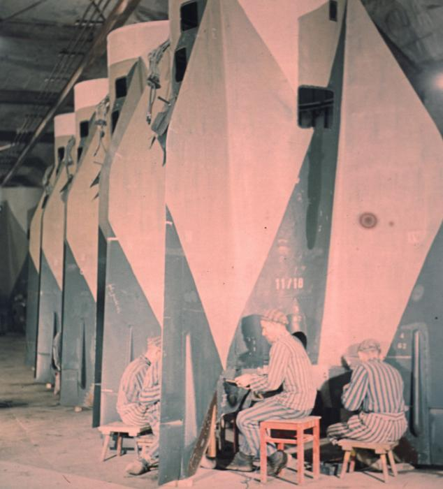 Mittelbau prisoners work on the tail assembly of the V2 rocket, possibly in Hall 35, 1944.