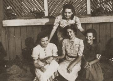 Four girls who are members of the Hanoar Hatzioni Zionist youth movement in the Sosnowiec ghetto.