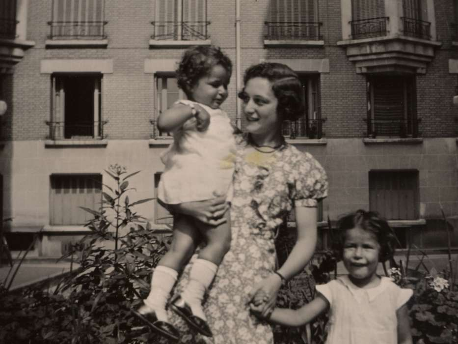 Julie van Weenen poses with her two young cousins Manuela and Jacqueline Mendels outside the girls' Paris apartment.