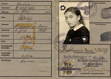 "Subsequent legislation from the Nuremberg Laws forced most Jews to adopt ""Israel"" as a middle name if they were male, or ""Sarah"" if they were female. Later, their identity papers were stamped with a letter ""J"" in red, indicating that the bearer was Jewish. Here the German identification papers for Marion Wolff include the forced middle name ""Sara"" and the letter ""J"" in red. Berlin, Germany, March 27, 1935."