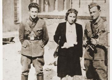 Three former Jewish partisans pose in the Vilna ghetto soon after the liberation. Pictured from left to right are; Joseph Harmatz; Valia Pszewalska and Avraham Sabrin (the last commander of the partisan La Nitzachon battalion). <i>US Holocaust Memorial Museum, courtesy of Joseph Harmatz</i>