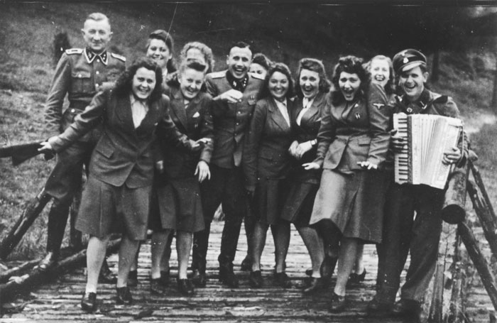 The SS female auxiliaries (Helferinnen) run down a ramp in Solahütte to the music of an accordion.