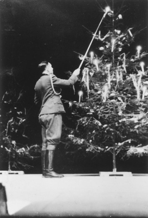 Yuletime, 1944. Karl Höcker lights the candles on the Yule tree.
