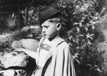 Fritz Glueckstein, a young German Jewish boy, poses in traditional German costume.