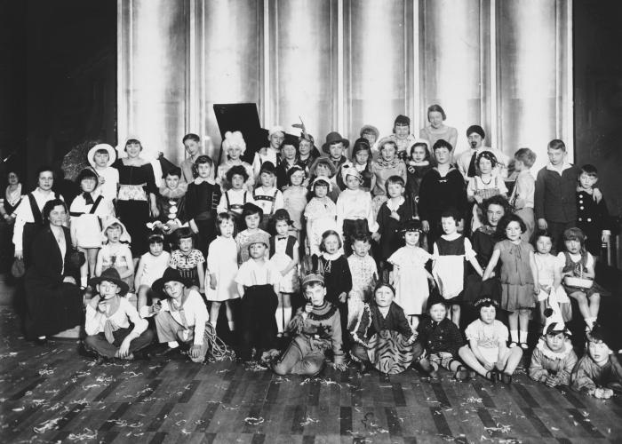 Class portrait of Jewish school children dressed in Purim costumes. Among them is Fritz Glueckstein.