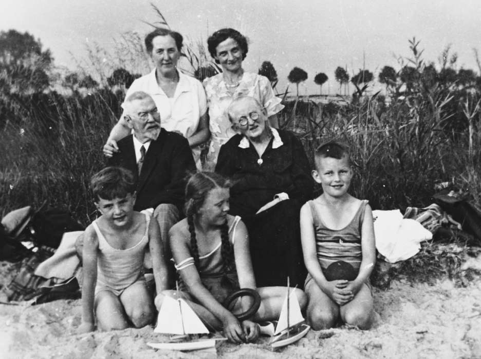 Fritz (bottom left), his mother (back right) and his adoptive grandparents.