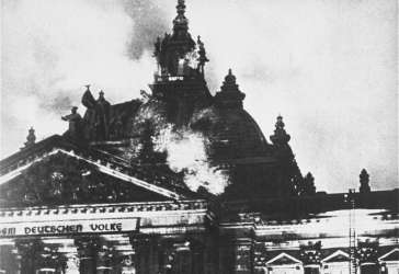 The Reichstag (German parliament) building burns in Berlin. Hitler used the event to convince President Hindenburg to declare a state of emergency, suspending important constitutional safeguards. Germany, February 27, 1933.