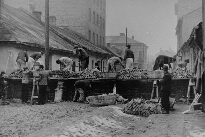 Jews at forced labor constructing the wall around the Krakow ghetto. Krakow, Poland, 1941.