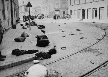 A major street in Krakow, strewn with the bundles of deported Jews, after the liquidation of the ghetto. Krakow, Poland, 1943.