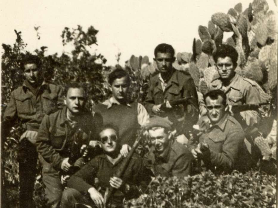 Group portrait of a Hagannah unit during the War of Independence. David Bayer stands in the second row, third from the left.