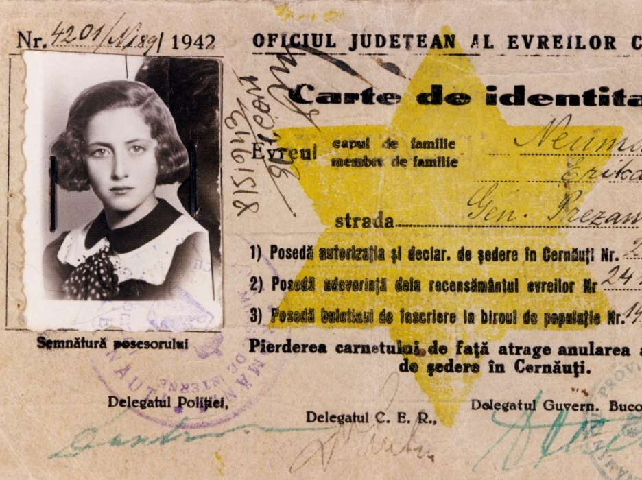 Official identification issued by the County Office of the Jews of Cernauti to Erika Neuman, authorizing her to remain in Cernauti.