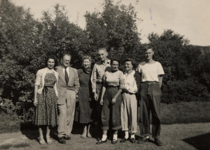 The Engel family poses on their farm in upstate New York. Ludwig Engel stands in the center with his daughter Katie, wife Greta, and son Adi to his right.
