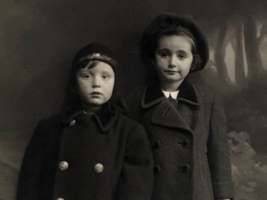 Studio portrait of Katie and Adi Engel taken after fleeing with their mother to Hungary.