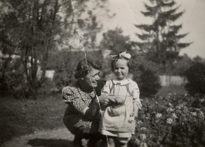 A young Katie Engel stands with her mother on her uncle's farm in Czechloslovakia.