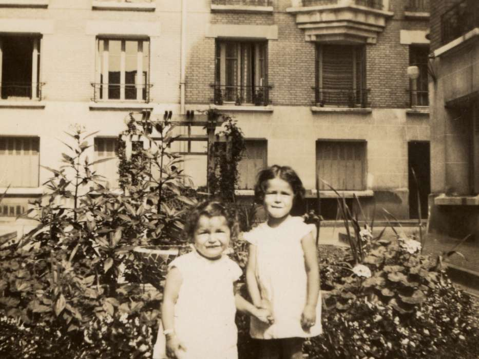 Jacqueline (left) and Manuela Mendels pose in the garden outside their apartment in Paris.