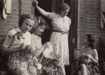 Jacqueline (second from left) and Manuela Mendels (far right) knit outside their uncle's home in Hilversum.