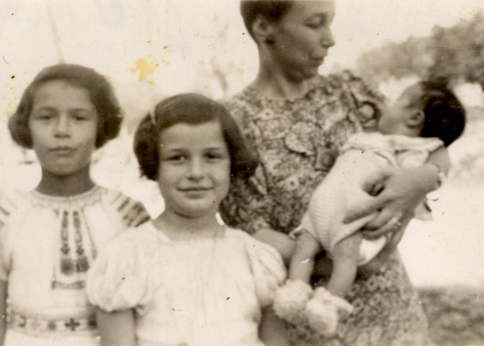 Portrait of a Jewish family in hiding. Pictured left to right are Manuela and Jacqueline Mendels, their mother Ellen, and their newborn brother Franklin.