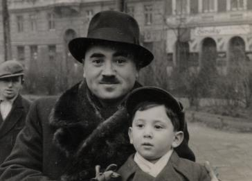 Close-up portrait of Cantor Yehuda Mandel and his son Manny on a street in Budapest.