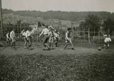 Children play soccer in a home in Heiden, Switzerland. Manny Mandel is pictured third from the left.