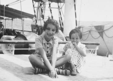 Gisela (right) and Inge Berg (left) sit on the deck of the Usambara while en route to Africa.