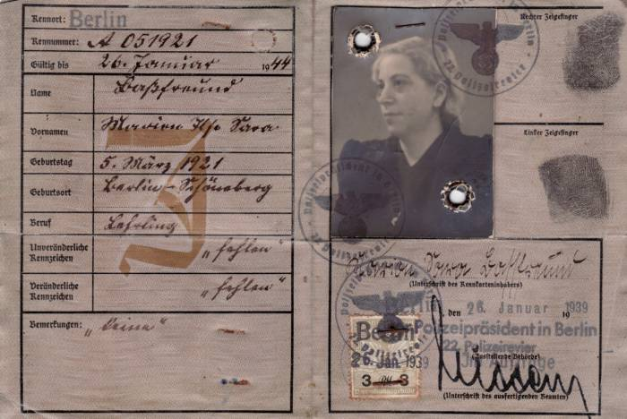 "Identification card issued to Marion Basfreund and stamped with a red J for Jude and the added middle name of ""Sara."""