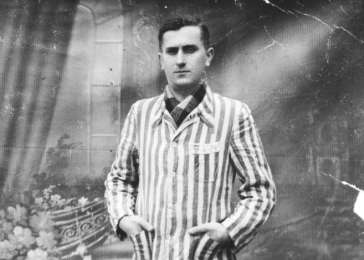 Studio portrait of David in his concentration camp jacket, taken shortly after liberation.