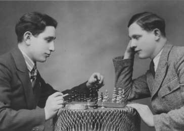 Miles (left) and Yona Lerman playing a game of chess in their home in Tomaszow Lubelski, Poland, 1935. <i>US Holocaust Memorial Museum</i>