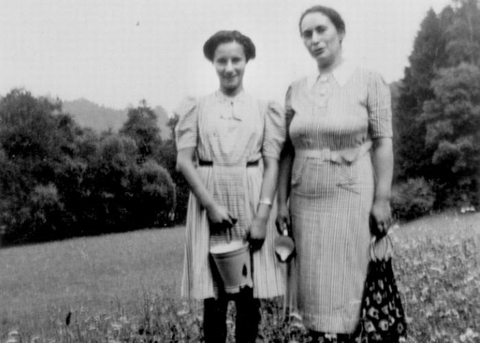 Susanne Strauss and her mother Bertha outside in a field near their home in Vacha, Germany.