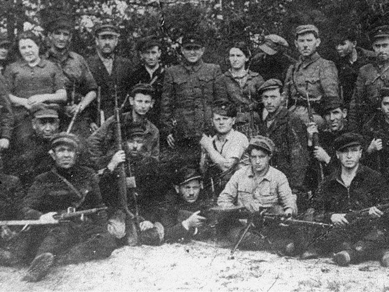 Resistance fighters pose with their weapons