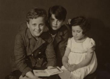 Studio portrait of three Czech Jewish siblings. Pictured from left to right are Felix, Bruno and Margit Morawetz.