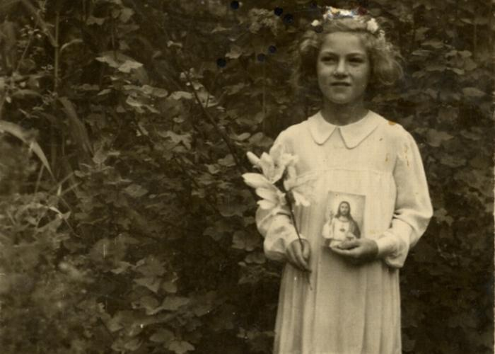 Halina Litman, nine years old, takes her first communion while in hiding in Jaroslaw.