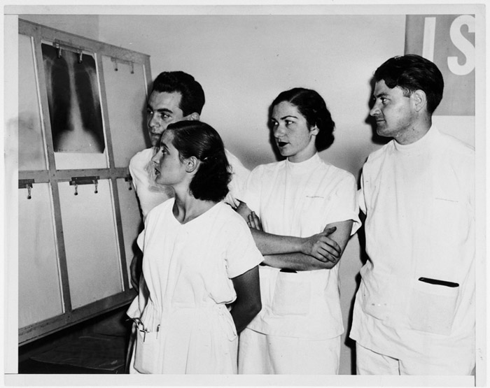 Pál Ornstein (left) and his wife, Anna Brunn Ornstein (second from left), study a lung x-ray with fellow medical students Luisa Schwarzwald and Stephen Hornstein. Heidelberg, Germany, 1949–1950.