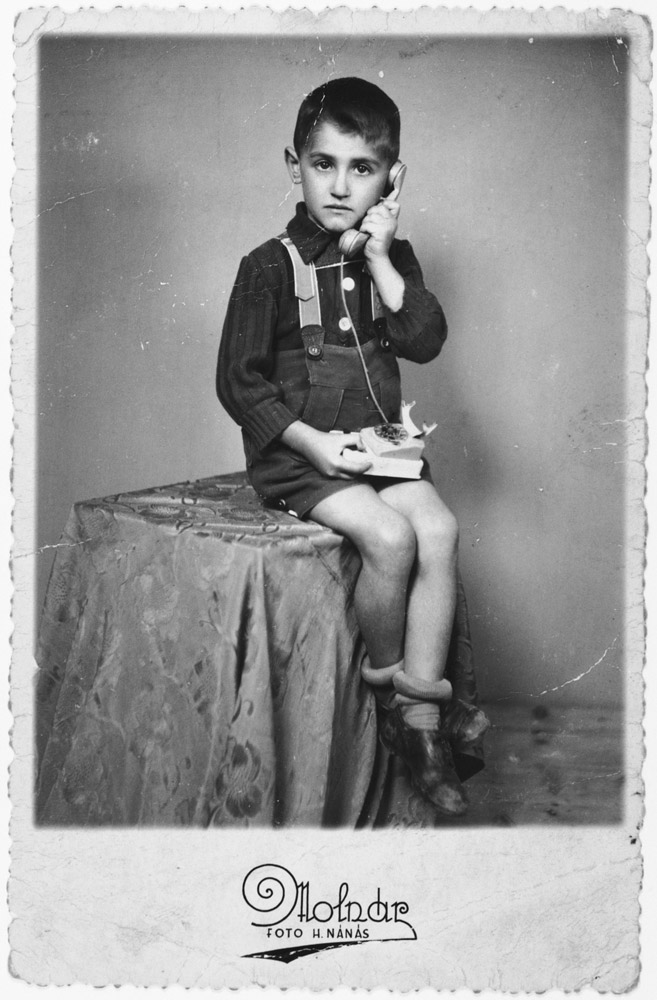 "Lászlo Ornstein poses with a telephone for a studio portrait less than two years before he was killed in Auschwitz. The original photo inscription reads, ""I had called you, dear father, to let you know that your children are waiting for you together with Jutka and Lacika."" Hajdúnánás, Hungary, October 23, 1942."