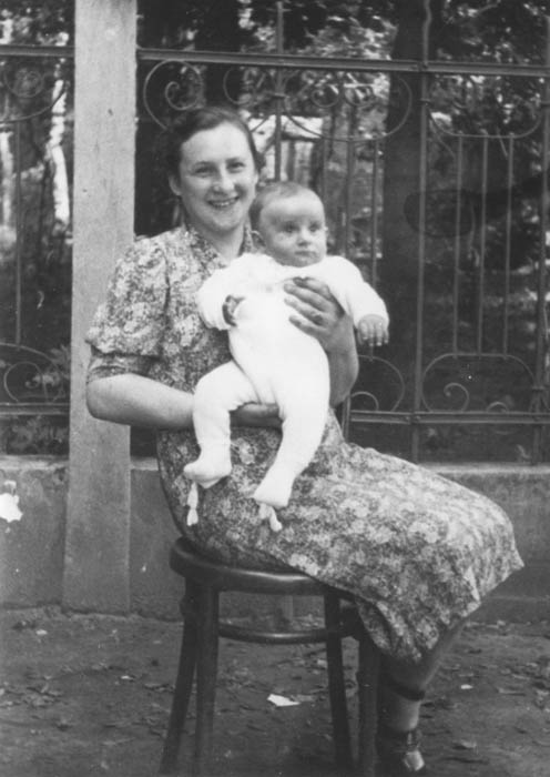 Blimcia (née Stapler) Rauchwerger holds her baby son Aizek two years before they both perished in Auschwitz. Chrzanow, Poland, 1941.